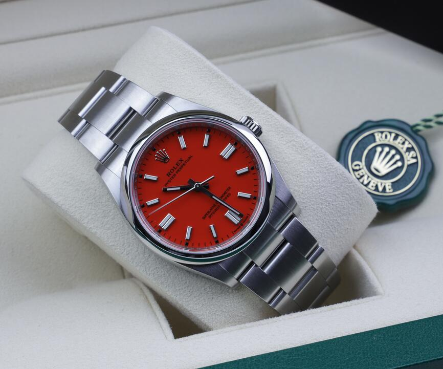 Swiss reproduction watches look evident with coral red color.